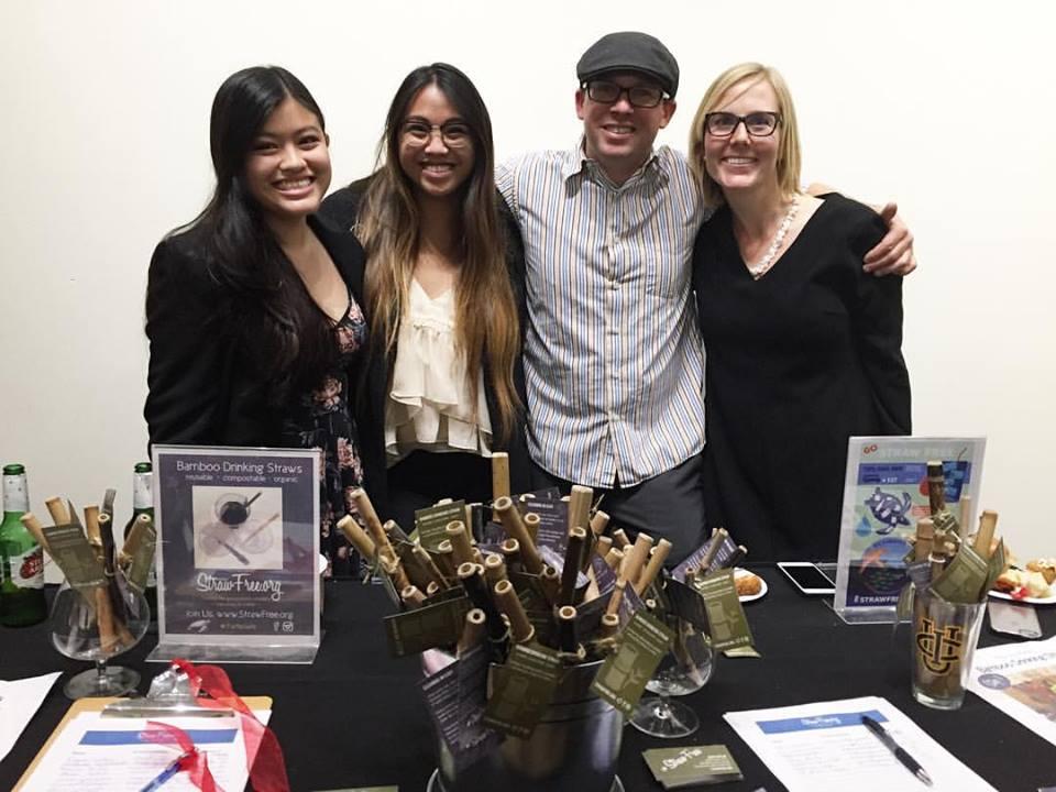 StrawFree Team at Plastic Oceans Art Exhibit. StrawFree team giving away bamboo straws at plastic oceans art exhibit.
