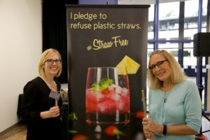 Plastic Ocean Artist, Bonnie Monteleone (right), and StrawFree.org founder, Diana Lofflin, pose with a bamboo straw.